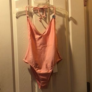 Pink open back one piece swimsuit
